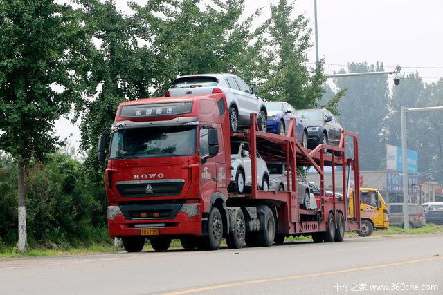 35度桑拿天湿身坚持干活 北京轿运车集散地尝司机百味